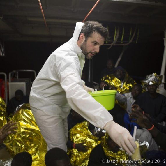 Chris Catrambone helping to distribute food to 146 people rescued from a rubber boat